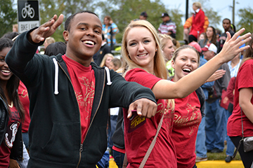 Photo of FSU Students walking in Homecoming Parade