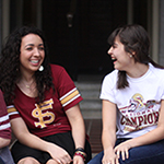 Photo of FSU students sitting on steps of one of FSU's Residence Halls