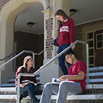 Photo of FSU students sitting on the steps of Bryan Hall