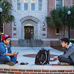 Photo of FSU students sitting outside of Landis Hall