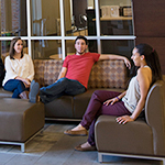 Photo of students lounging on campus